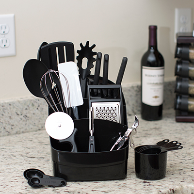 SUNBEAM<sup>®</sup> Cook's Kitchen Set - This countertop set provides the essential tools for cooking. Assortment includes such items as a slotted spatula, whisk, basting spoon, utility knife, measuring spoons and much more.  Includes space-saving caddy with built-in knife block to store everything.