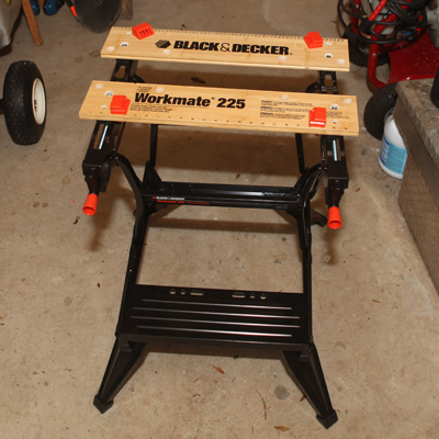 BLACK & DECKER<sup>&reg;</sup> Workmate<sup>&reg;</sup>  225-Portable Project Center and Vise - The Workmate<sup>&reg;</sup> 225 is the perfect addition to your home shop! You can use it as a workbench, a bench tool stand or a sawhorse. It features adjustable rear jaws which provide versatility and stability when clamping materials. Also, the Workmate's legs fold under to provide lower height for larger projects and adjustable swivel pegs to allow you to hold almost anything!